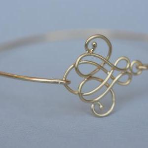 Cursive Gold Knot Bangle- Gold Brac..